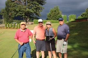 Compass Housing Alliance's Rick Freidoff with his foursome, including Phillips Owner, Lou Micheli