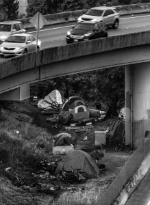 Friday October 23, 2015. Squaters camping out under the Highway 5 overpass to Highway 90 in Seattle. (Photo Credit: Seattle Times)
