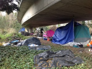 "An estimated 400 people lived in a three-mile stretch under I-5 known as ""the Jungle."" Photo Credit: The Stranger"